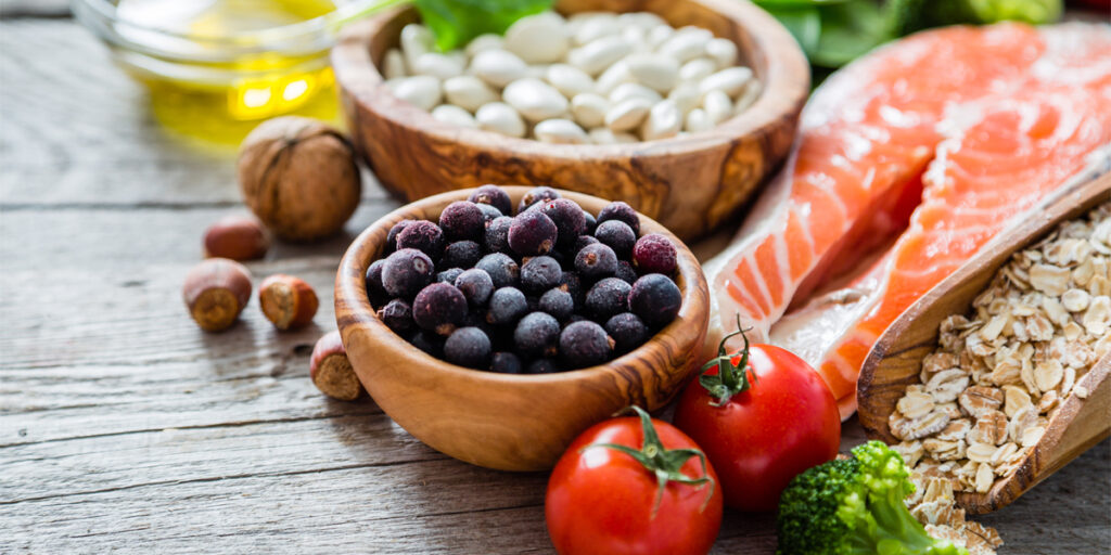 Selection of food that is good for the heart, rustic wood background; Shutterstock ID 376923973